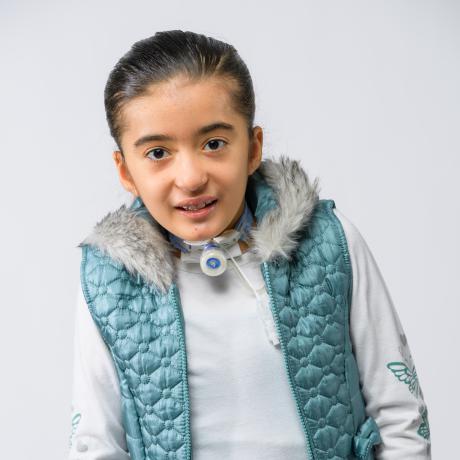Ariella smiling in blue vest