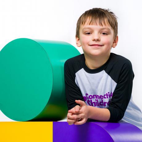 Eli poses with Logo Child
