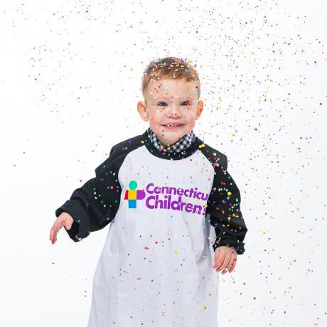 Brady grins through a shower of confetti