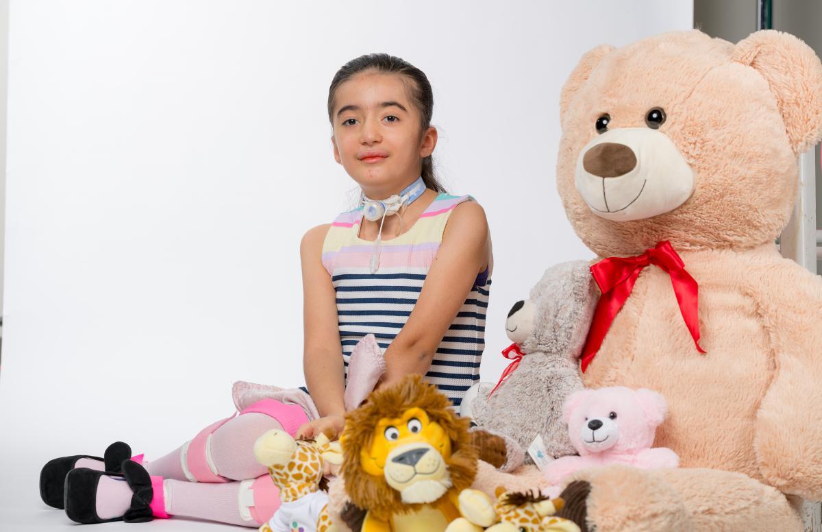 Ariella with stuffed animals