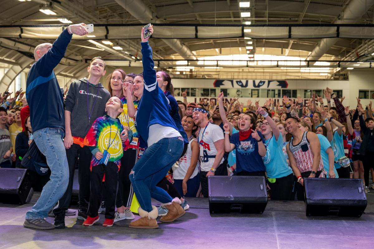 Family takes a selfie at Huskython after sharing their story